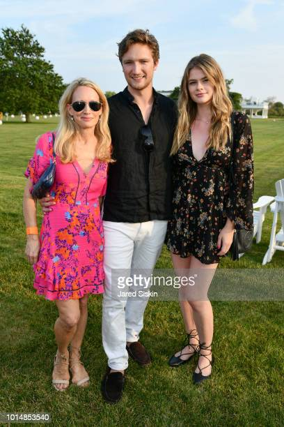 Amber Turner Benton Turner and Dominique Booth attend Peconic Baykeeper Drink Swim Fish In Southampton on August 10 2018 in Southampton New York