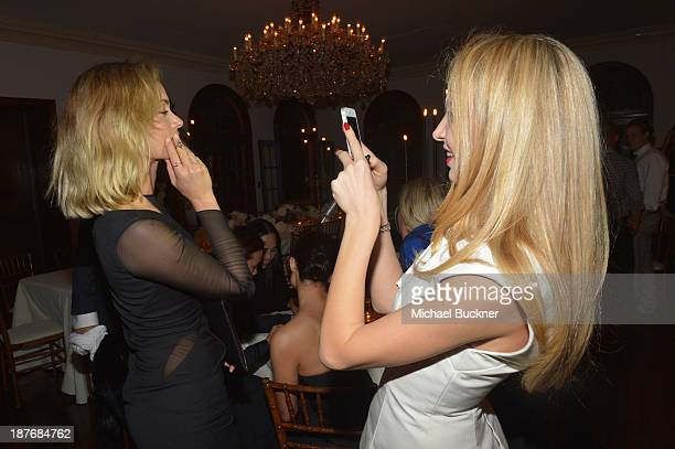 Amber Valetta and Sabine Ghanem attend the Sabine G Jewelry Dinner at Balthazar and Rosetta Getty's home on November 8 2013 in Los Angeles California