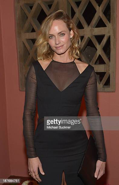 Amber Valetta attends the Sabine G Jewelry Dinner at Balthazar and Rosetta Getty's home on November 8 2013 in Los Angeles California
