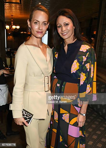 Amber Valletta and Caroline Rush attends The Fashion Awards in partnership with Swarovski nominees' lunch hosted by the British Fashion Council with...