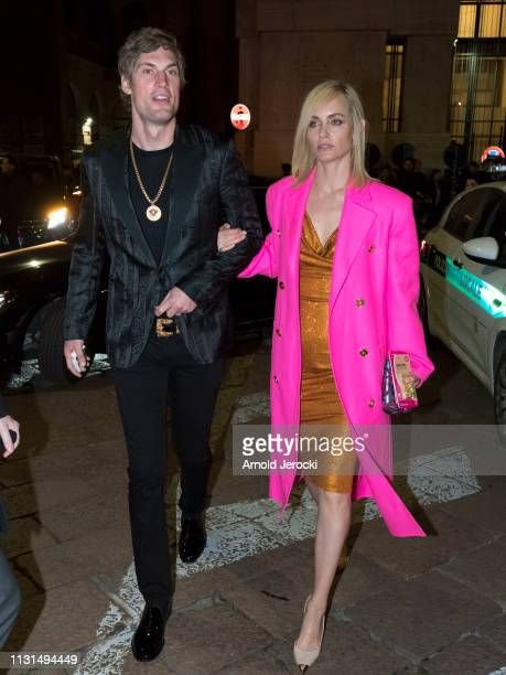 Amber Valletta and guest are seen leaving Versace fashion show on Day 3 Milan Fashion Week Autumn/Winter 2019/20 on February 22 2019 in Milan Italy