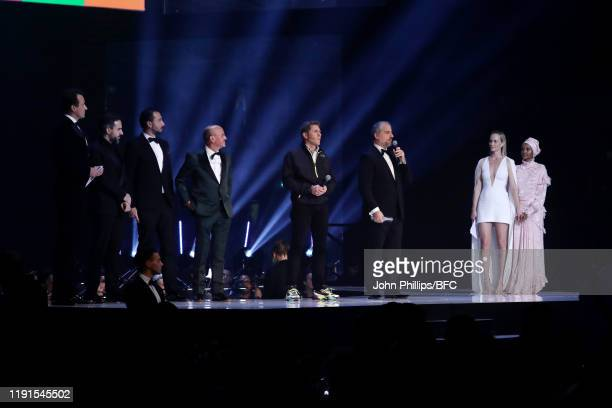 Amber Valletta and Halima Aden stand next to the winners of the Positive Change Award on stage during The Fashion Awards 2019 held at Royal Albert...