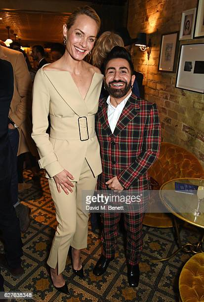 Amber Valletta and Johnny Coca attend The Fashion Awards in partnership with Swarovski nominees' lunch hosted by the British Fashion Council with...
