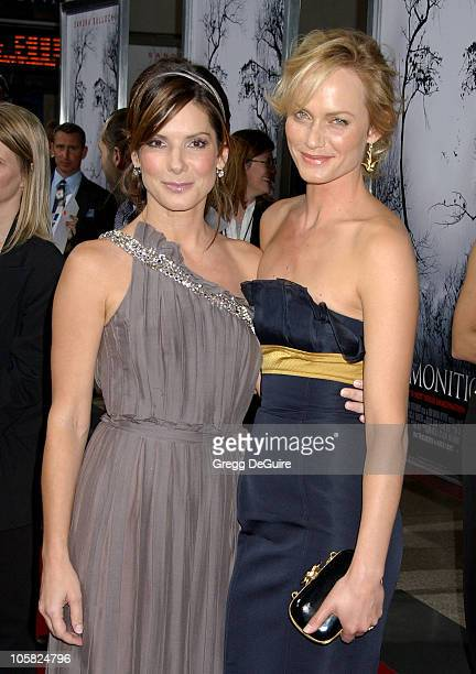 Amber Valletta and Sandra Bullock during 'Premonition' Los Angeles Premiere Arrivals at Cinerama Dome in Hollywood California United States