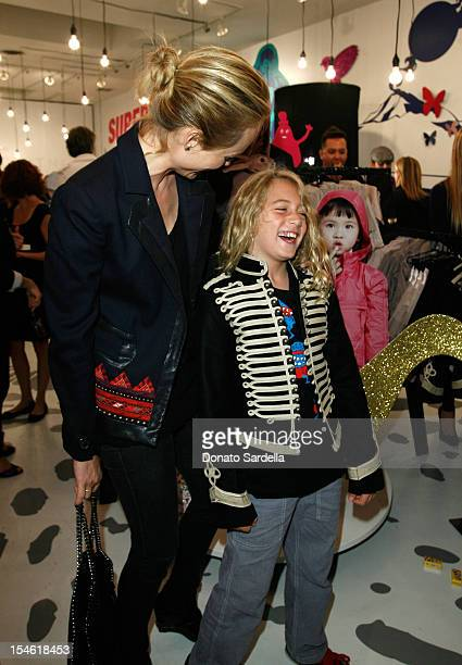 Amber Valletta and son Auden McCaw attend the Stella McCartney for GapKids Pop Up Store event on November 4 2009 in Beverly Hills California