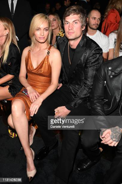 Amber Valletta and Teddy Charles attend the Versace show at Milan Fashion Week Autumn/Winter 2019/20 on February 22 2019 in Milan Italy