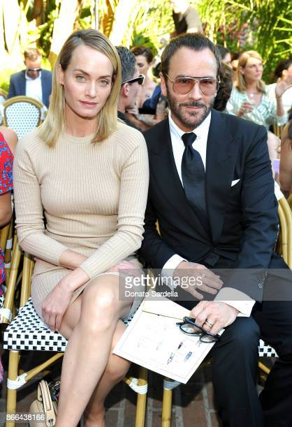 Amber Valletta and Tom Ford attend CFDA/Vogue Fashion Fund Show and Tea at Chateau Marmont at Chateau Marmont on October 25 2017 in Los Angeles...