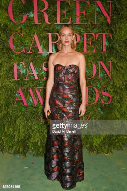 Amber Valletta attends the Green Carpet Fashion Awards Italia wearing Missoni for the Green Carpet Challenge at Teatro Alla Scala on September 24...
