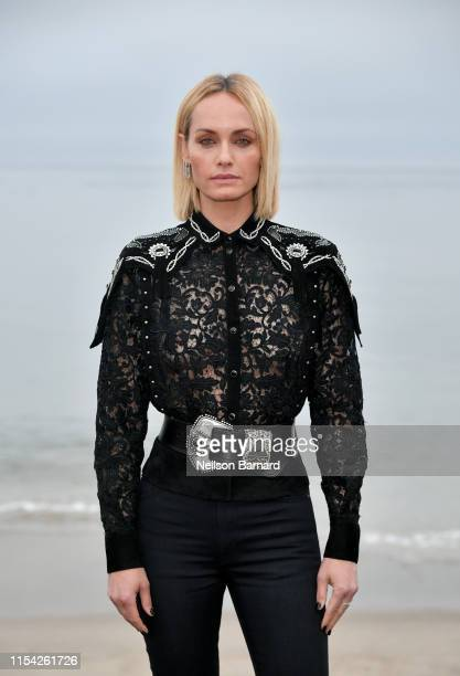 Amber Valletta attends the Saint Laurent Mens Spring Summer 20 Show on June 06 2019 in Paradise Cove Malibu California