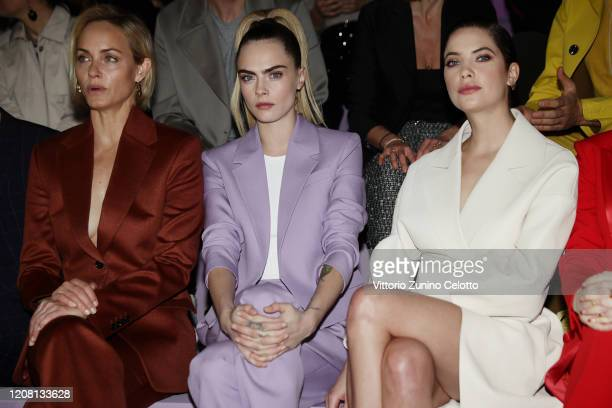 Amber Valletta Cara Delevingne and Ashley Benson attend the BOSS fashion show during the Milan Fashion Week Fall/Winter 2020 2021 on February 23 2020...