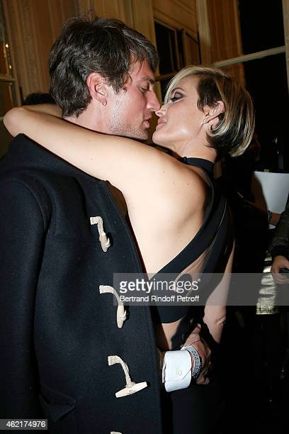 Amber Valletta gives a kiss to her boyfriend as they attend the Versace show as part of Paris Fashion Week Haute Couture Spring/Summer 2015 on...