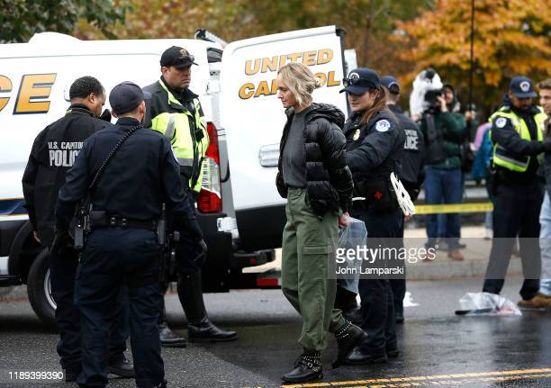 Amber Valletta is arrested near the US Capitol during Fire Drill Friday climate change protest on November 22 2019 in Washington DC Protesters are...