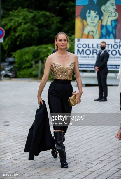 Amber Valletta is seen wearing golden off shoulder top, cropped pants, golden bag and boots outside Louis Vuitton Parfum Hosts Dinner at Fondation...