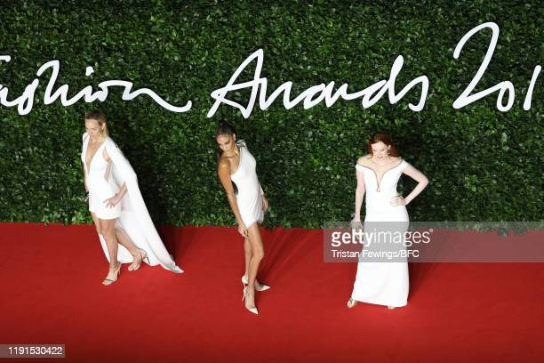 Amber Valletta Joan Smalls and Karen Elson arrive at The Fashion Awards 2019 held at Royal Albert Hall on December 02 2019 in London England