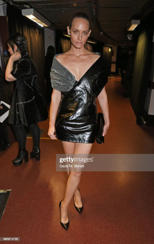 Amber Valletta poses backstage at The Fashion Awards 2017 in partnership with Swarovski at Royal Albert Hall on December 4, 2017 in London, England.