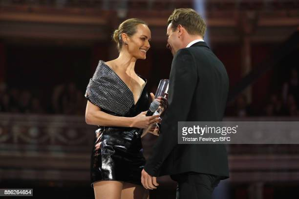 Amber Valletta presents Jonathan Anderson with the Accessories Designer of the Year award on stage during The Fashion Awards 2017 in partnership with...