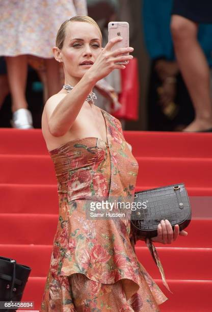 Amber Valletta takes a photo with her phone as she attends the 'Wonderstruck' screening during the 70th annual Cannes Film Festival at Palais des...