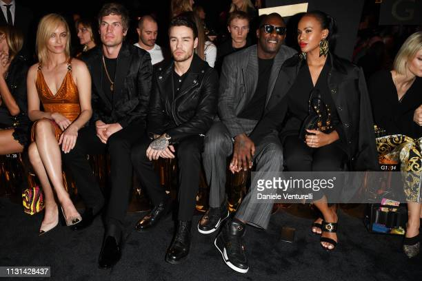 Amber Valletta Teddy Charles Liam Payne Idris Elba and Sabrina Dhowre attend the Versace show at Milan Fashion Week Autumn/Winter 2019/20 on February...