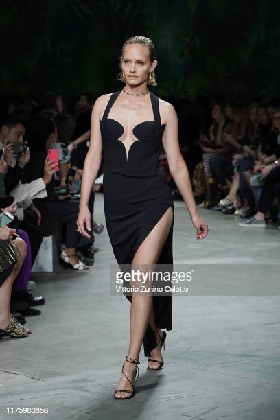 Amber Valletta walks the runway at the Versace show during the Milan Fashion Week Spring/Summer 2020 on September 20, 2019 in Milan, Italy.