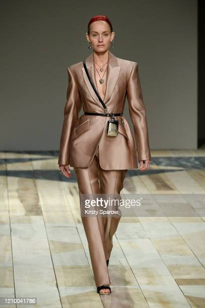 Amber Valletta walks the runway during the Alexander McQueen as part of Paris Fashion Week Womenswear Fall/Winter 2020/2021 on March 02, 2020 in...