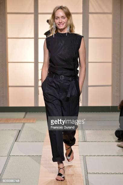 Amber Valletta walks the runway during the HM show as part of the Paris Fashion Week Womenswear Fall/Winter 2018/2019 on February 28 2018 in Paris...