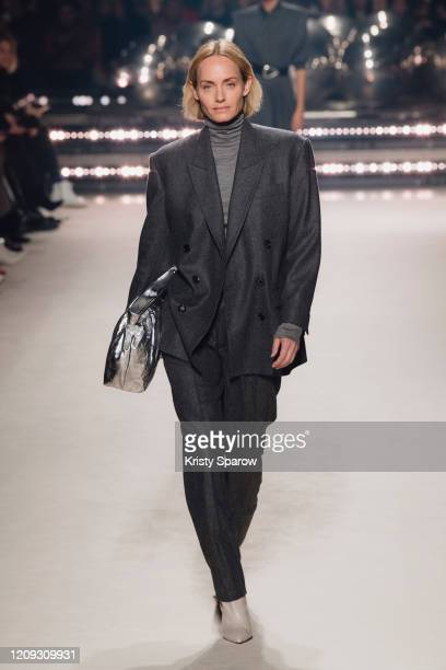 Amber Valletta walks the runway during the Isabel Marant show as part of Paris Fashion Week Womenswear Fall/Winter 2020/2021 on February 27, 2020 in...