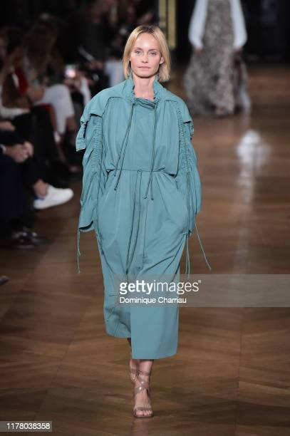 Amber Valletta walks the runway during the Stella McCartney Womenswear Spring/Summer 2020 show as part of Paris Fashion Week on September 30, 2019 in...