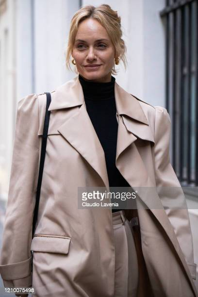 Amber Valletta, wearing a beige trench coat, is seen outside Isabel Marant, during Paris Fashion Week - Womenswear Fall/Winter 2020/2021 : Day Four...