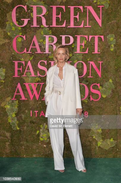 Amber Valletta wearing Agnona attends The Green Carpet Fashion Awards Italia 2018 at Teatro Alla Scala on September 23 2018 in Milan Italy