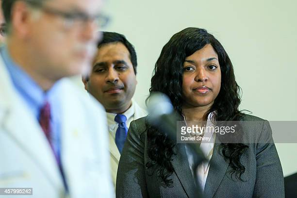 Amber Vinson a Texas nurse who contracted Ebola after treating an infected patient listens as Dr Bruce Ribner an epidemiologist and professor in the...