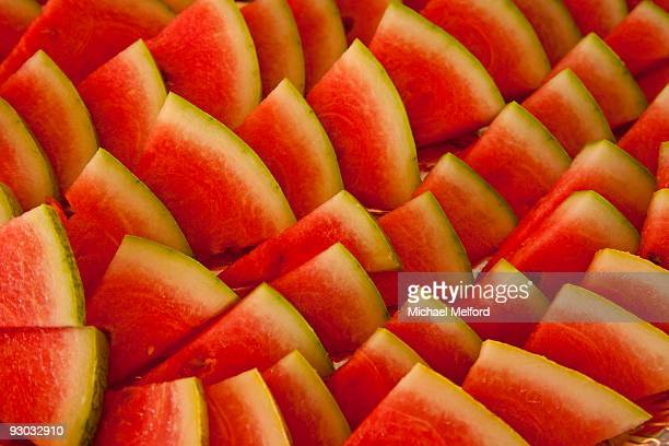 A close-up of slices of watermelon.
