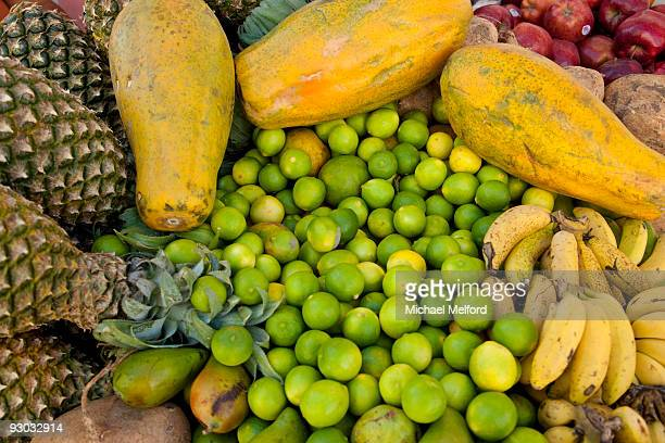 Exotic, tropical fruits including pineapples, limes and papaya.