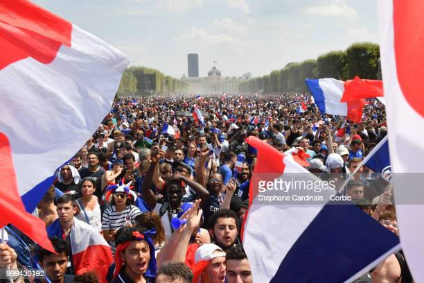 This picture taken from Trocadero on July 15 2018 shows the Eiffel Tower illuminated in French national colors during celebrations after the Russia...