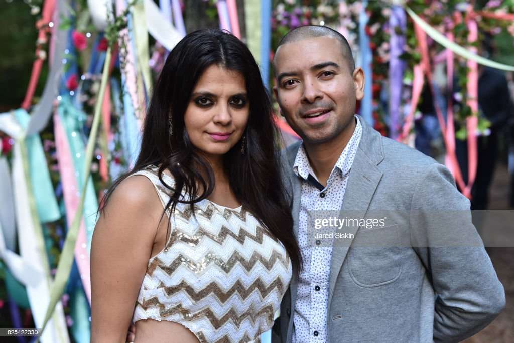 Ambika Kataria and Steve Rivera attend The 24th Annual Watermill Center Summer Benefit & Auction at The Watermill Center on July 29, 2017 in Water Mill, New York.