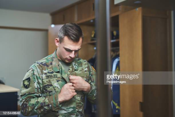 ambition is ambition, whether you're wearing a suit or fatigues - military uniform stock pictures, royalty-free photos & images