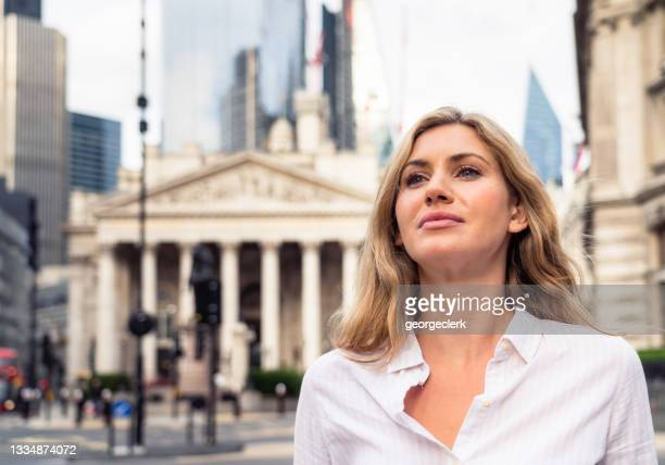 ambitious financial sector worker - finance stock pictures, royalty-free photos & images