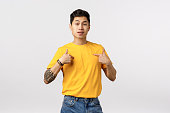 ambitious handsome asian male snob yellow