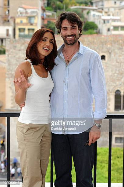 Ambra Angiolini and Luca Calvani attend the Taormina Film Fest 2010 Photocall on June 14 2010 in Taormina Italy