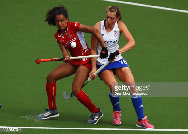 Ambre Ballenghien of Belgium battles for the ball with Giselle Ansley of Great Britain during the Women's FIH Field Hockey Pro League match between...