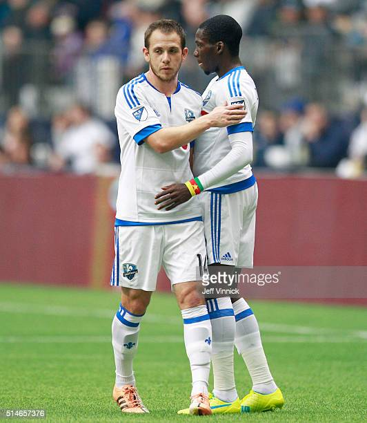 Ambroise Oyongo and Harrison Shipp of the Montreal Impact embrace during their MLS game against the Vancouver Whitecaps March 6 2016 at BC Place in...