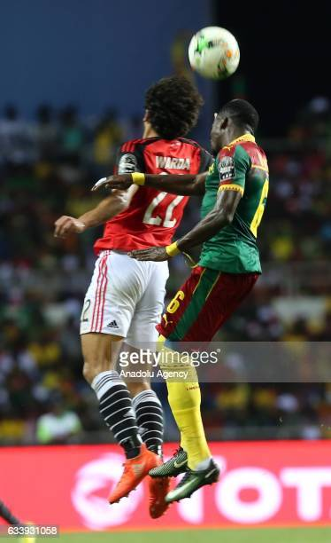 Ambroise Oyongo of Cameroon in action against Amr Warda of Egypt during the 2017 Africa Cup of Nations final football match between Egypt and...