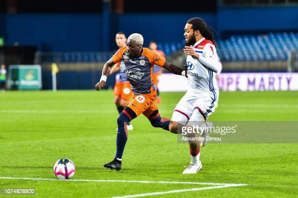 Ambroise Oyongo of Montpellier and Jsaon Denayer of Lyon during the Ligue 1 match between Montpellier and Lyon at Stade de la Mosson on December 22...