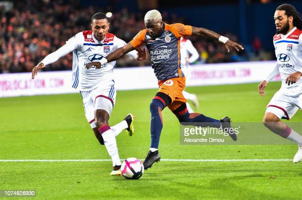 Ambroise Oyongo of Montpellier and Marcelo of Lyon during the Ligue 1 match between Montpellier and Lyon at Stade de la Mosson on December 22 2018 in...