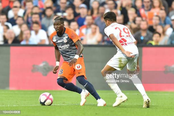 Ambroise Oyongo of Montpellier during the Ligue 1 match between Montpellier and Nimes at Stade de la Mosson on September 30 2018 in Montpellier France
