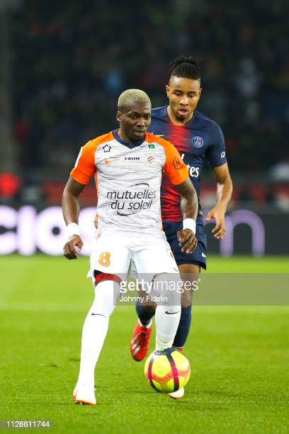 Ambroise Oyongo of Montpellier during the Ligue 1 match between Paris Saint Germain and Montpellier at Parc des Princes on February 20 2019 in Paris...