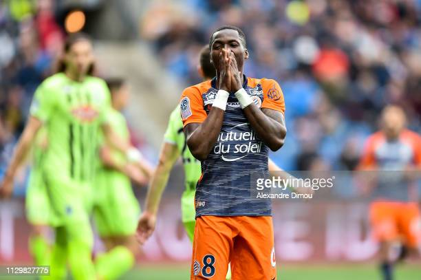 Ambroise Oyongo of Montpellier looks dejected during the Ligue 1 match between Montpellier and Angers at Stade de la Mosson on March 10 2019 in...