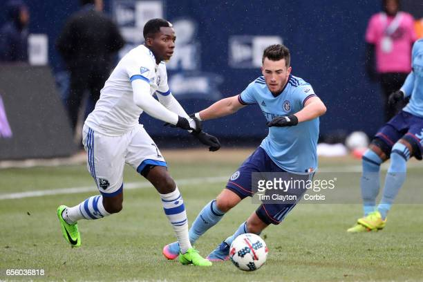 Ambroise Oyongo of Montreal Impact is challenged by Jack Harrison of New York City FC during the New York City FC Vs Montreal Impact regular season...