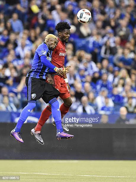 Ambroise Oyongo of the Montreal Impact and Tosaint Ricketts of the Toronto FC jump for the ball during leg one of the MLS Eastern Conference finals...