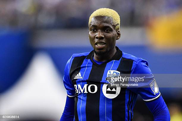 Ambroise Oyongo of the Montreal Impact looks on during leg one of the MLS Eastern Conference finals against the Toronto FC at Olympic Stadium on...
