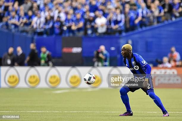 Ambroise Oyongo of the Montreal Impact looks to play the ball during leg one of the MLS Eastern Conference finals against the Toronto FC at Olympic...